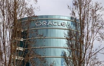 REDWOOD SHORES, CA - MARCH 20:  Oracle headquarters is seen through trees on March 20, 2012 in Redwood Shores, California.  Oracle will report third quarter earnings today after the closing bell. (Photo by Justin Sullivan/Getty Images) By Justin Sullivan