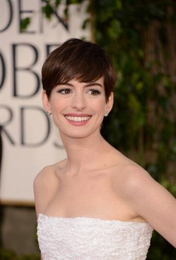 BEVERLY HILLS, CA - JANUARY 13:  Actress Anne Hathaway arrives at the 70th Annual Golden Globe Awards held at The Beverly Hilton Hotel on January 13, 2013 in Beverly Hills, California.  (Photo by Jason Merritt/Getty Images) By Jason Merritt
