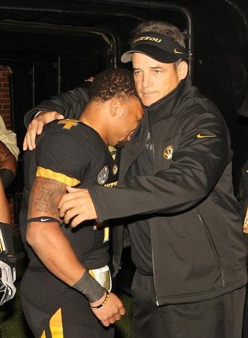 Missouri Tigers head coach Gary Pinkel consols senior Kendial Lawrence before a game against the Syracuse Orangemen on Senior Day at Faurot Field in Columbia, Missouri on November 17, 2012.    UPI/Bill Greenblatt By BILL GREENBLATT