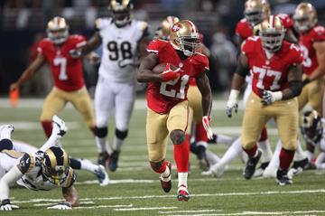 San Francisco 49ers Frank Gore sprints past the St. Louis Rams defense for a 34-yard touchdown in the second quarter against the St. Louis Rams at the Edward Jones Dome in St. Louis on September 26, 2013.   UPI/Bill Greenblatt By BILL GREENBLATT