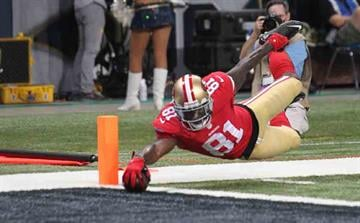San Francisco 49ers Anquan Boldin just gets the football over the goal line for a touchdown in the second quarter against the St. Louis Rams at the Edward Jones Dome in St. Louis on September 26, 2013.   UPI/Bill Greenblatt By BILL GREENBLATT