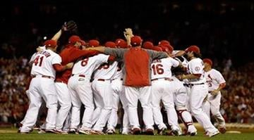 Members of the St. Louis Cardinals celebrate after the Cardinals' 7-0 win over the Chicago Cubs in a baseball game to clinch the NL Central title Friday, Sept. 27, 2013, in St. Louis. (AP Photo/Jeff Roberson) By Jeff Roberson