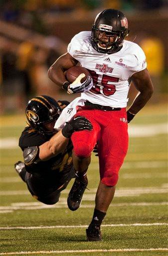Arkansas State's David Oku, right, runs past Missouri's Andrew Wilson, left, during the first half of an NCAA college football game Saturday, Sept. 28, 2013, in Columbia, Mo. (AP Photo/L.G. Patterson) By L.G. Patterson
