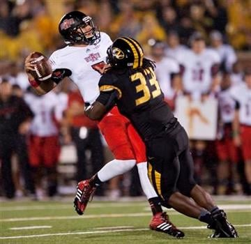 Missouri's Markus Golden, right, hits Arkansas State quarterback Adam Kennedy as he throws in the final seconds of the first half of an NCAA college football game Saturday, Sept. 28, 2013, in Columbia, Mo. (AP Photo/L.G. Patterson) By L.G. Patterson
