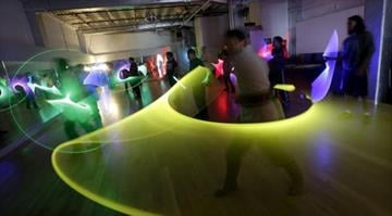 Jim Collum, foreground, and other students work on light saber skills during a Golden Gate Knights class in San Francisco, Sunday, Feb. 10, 2013. / AP PHOTO/JEFF CHIU By Brendan Marks
