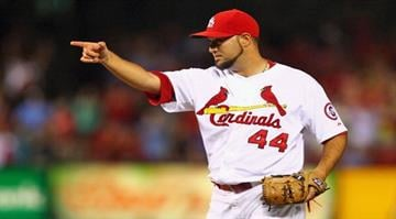 ST. LOUIS, MO - MAY 29: Reliever Edward Mujica #44 of the St. Louis Cardinals celebrates after beating the Kansas City Royals at Busch Stadium on May 29, 2013 in St. Louis, Missouri.  (Photo by Dilip Vishwanat/Getty Images) By Dilip Vishwanat