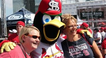 Hundreds of people on Thursday showed up to party during a pep rally outside Busch Stadium hours before the Cardinals were scheduled to take on the Pittsburgh Pirates in Game 1 of the NLDS.