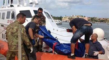 At least 114 die after crowded ship capsizes off Italy.  In the dark of night, hundreds of men, women and children are flung into the sea after the fishing boat capsizes following a fire on board. By HO, Health Care Service,AP Photo/Nino Randazzo
