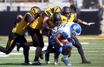 Kentucky Wildcats quarterback Patrick Towles is dragged down by the Missouri Tiger defense in the first quarter at Faurot Field in Columbia, Missouri on October 27, 2012. UPI/Bill Greenblatt By BILL GREENBLATT