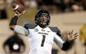 Missouri quarterback James Franklin passes against Vanderbilt in the first quarter of an NCAA college football game on Saturday, Oct. 5, 2013, in Nashville, Tenn. (AP Photo/Mark Humphrey) By Mark Humphrey