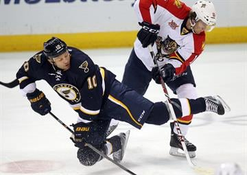 St. Louis Blues Brenden Morrow (10) is upended by Florida Panthers Jonathan Huberdeau in the first period at the Scottrade Center in St. Louis on October 5, 2013.   UPI/Bill Greenblatt By BILL GREENBLATT
