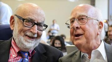Two win Nobel Prize for physics breakthrough.  Britain's Peter Higgs and Belgian Francois Englert are honored for their theory on how the building blocks of the universe clump together and form matter. By FABRICE COFFRINI/AFP / GETTYIMAGES