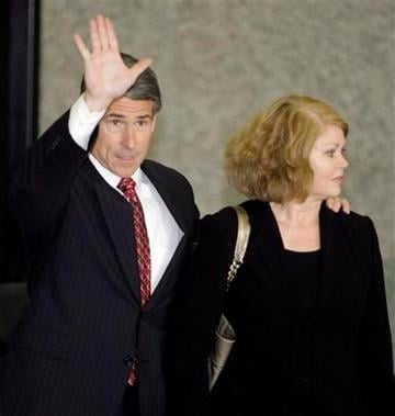 Robert Blagojevich, brother of former Illinois Gov. Rod Blagojevich and his wife Julie arrive at the Federal Court building, Tuesday, Aug. 17, 2010, in Chicago. (AP Photo/Kiichiro Sato) By Kiichiro Sato