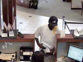 This photo shows a man suspected of robbing Commerce Bank on Lindbergh in Florissant on July 28, 2010. By KMOV Web Producer