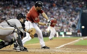 Houston Astros' Pedro Feliz hits a two-run double as Pittsburgh Pirates catcher Chris Snyder, left, awaits the pitch during the sixth inning of a baseball game Sunday, Aug. 15, 2010, in Houston. (AP Photo/David J. Phillip) By David J. Phillip