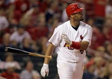 St. Louis Cardinals' Albert Pujols tosses his bat as he watches his solo home run during the eighth inning of a baseball game against the San Francisco Giants, Friday, Aug. 20, 2010, in St. Louis. (AP Photo/Jeff Roberson) By Jeff Roberson