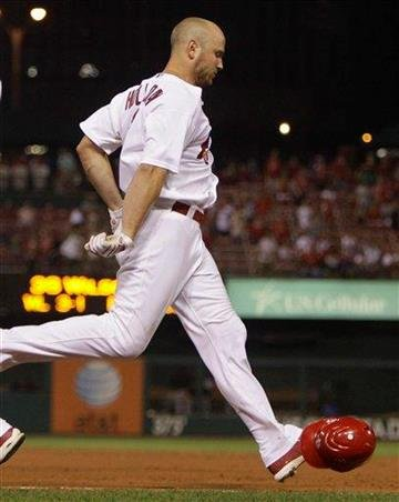 St. Louis Cardinals' Matt Holliday throws down his batting helmet after grounding out to end a baseball game against the San Francisco Giants, Friday, Aug. 20, 2010, in St. Louis. The Giants won 6-3. (AP Photo/Jeff Roberson) By Jeff Roberson