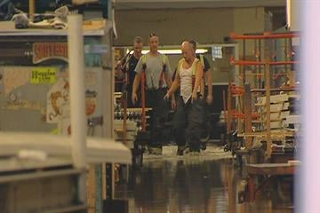 Crews waded through the water from a broken water main that flooded Winco Windows in University City Saturday. By KMOV Web Producer