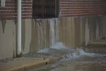 Water spills out onto the street in University City. By KMOV Web Producer
