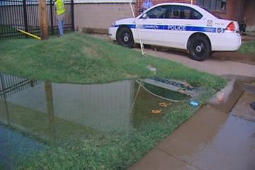 Water floods the grass after a water main broke in University City. By KMOV Web Producer