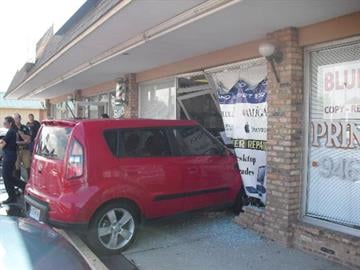Red Kia Soul crashes into St. Charles business By KMOV