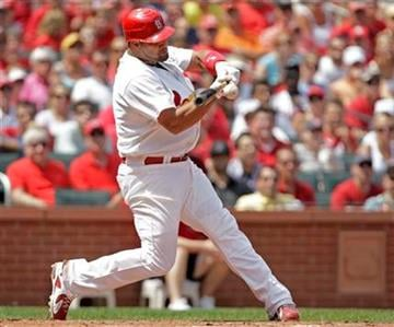 St. Louis Cardinals' Albert Pujols connects for an RBI-single in the third inning of a baseball game against the San Francisco Giants, Sunday, Aug. 22, 2010, in St. Louis. (AP Photo/Tom Gannam) By Tom Gannam