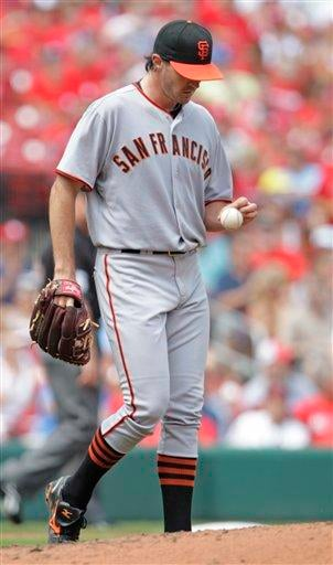 San Francisco Giants starting pitcher Barry Zito checks out a new ball after surrendering back-to-back RBIs in the third inning of a baseball game against the St. Louis Cardinals, Sunday, Aug. 22, 2010, in St. Louis. (AP Photo/Tom Gannam) By Tom Gannam