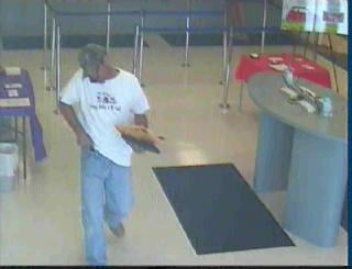 Suspect surveillance photos show bank robbery suspect at the First Community Credit Union in Arnold on Aug. 19, 2010. Police say the suspect seen here might be connected to several other area robberies.