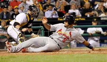 St. Louis Cardinals' Albert Pujols, right, scores from second on a hit by Cardinals' Matt Holliday in the Cardinals' three-run fifth inning of the baseball game in Pittsburgh,  Monday, Aug. 23, 2010. (AP Photo/Keith Srakocic) By Keith Srakocic
