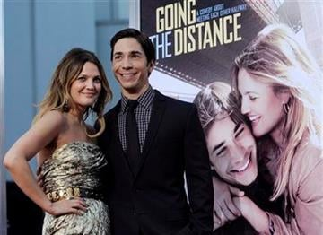 """Drew Barrymore, left, and Justin Long, co-stars of """"Going the Distance,"""" pose together at the premiere of the film, Monday, Aug. 23, 2010, in Los Angeles. (AP Photo/Chris Pizzello) By Chris Pizzello"""