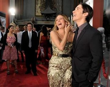 """Drew Barrymore, left, and Justin Long, fellow cast members in """"Going the Distance,"""" share a laugh at the premiere of the film, Monday, Aug. 23, 2010, in Los Angeles. (AP Photo/Chris Pizzello) By Chris Pizzello"""