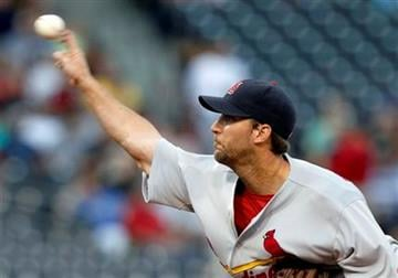 St. Louis Cardinals starting pitcher Adam Wainwright throws against the Pittsburgh Pirates in the first inning of the baseball game in Pittsburgh, Tuesday, Aug. 24, 2010. (AP Photo/Keith Srakocic) By Keith Srakocic