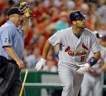 St. Louis Cardinals' Albert Pujols watches his 400th home run in the fourth inning of a baseball game with the Washington Nationals at Nationals Park in Washington Thursday, Aug. 26, 2010. (AP Photo/Alex Brandon) By Alex Brandon