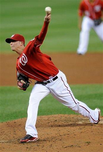 Washington Nationals starting pitcher Scott Olsen (19) delivers a pitch against the St. Louis Cardinals during the third inning of a baseball game, Friday, Aug. 27, 2010, in Washington. (AP Photo/Nick Wass) By Nick Wass