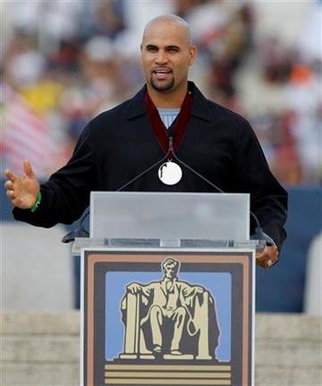 "St. Louis Cardinals baseball player Albert Pujols wears his medal as he speaks at the Glenn Beck ""Restoring Honor"" rally in front of the Lincoln Memorial in Washington Saturday, Aug. 28, 2010.(AP Photo/Alex Brandon) By Alex Brandon"