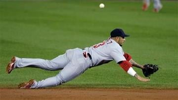St. Louis Cardinals second baseman Felipe Lopez dives for a ball on a hit by the Washington Nationals during the third inning of their baseball game at Nationals Park in Washington, Saturday, Aug. 28, 2010. (AP Photo/Susan Walsh) By Susan Walsh