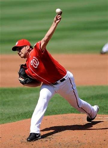 Washington Nationals starter John Lannan delivers a pitch against the St. Louis Cardinals during the third inning of a baseball game Sunday, Aug. 29, 2010, in Washington. (AP Photo/Nick Wass) By Nick Wass