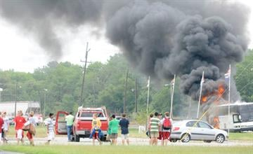 Paul Newton / The SouthernCarbondale firefighters work to extinguish a fire from the back of a tour bus that wasy carrying students from Mary Institute and Saint Louis Country Day School on Monday, Aug. 30, just north of Carbondale, Ill., on U.S. 51.