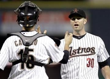Houston Astros pitcher J.A. Happ (30) celebrates with catcher Jason Castro (15) the Astros beat the St. Louis Cardinals 3-0 in a baseball game Monday, Aug. 30, 2010, in Houston. Happ threw a two-hitter. (AP Photo/David J. Phillip) By David J. Phillip
