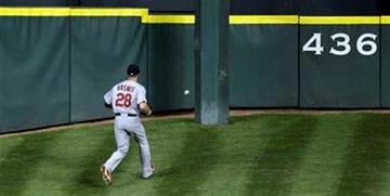 St. Louis Cardinals center fielder Colby Rasmus chases a two-run triple hit by Houston Astros' Hunter Pence during the fourth inning of a baseball game Tuesday, Aug. 31, 2010, in Houston. (AP Photo/David J. Phillip) By David J. Phillip