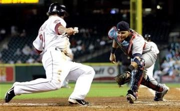 Houston Astros' Brett Wallace, left, is tagged out by St. Louis Cardinals catcher Yadier Molina, right, while trying to score during the fifth inning of a baseball game Wednesday, Sept. 1, 2010, in Houston. (AP Photo/David J. Phillip) By David J. Phillip