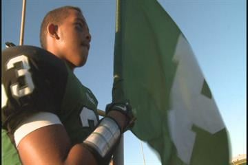 Pattonville High School football player holds the school flag before the team's game against Hazelwood Central on Friday, September 3, 2010.