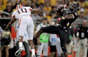 Missouri safety Jasper Simmons, right, intercepts a pass intended for Illinois wide receiver Eddie McGee, left, during the second quarter of an NCAA college football game Saturday, Sept. 4, 2010, in St. Louis. (AP Photo/Jeff Roberson) By Jeff Roberson