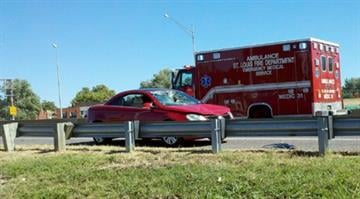 A teenager was struck by a red Volkswagen (pictured) while crossing Interstate 55. By KMOV Web Producer