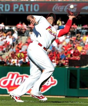St. Louis Cardinals first baseman Albert Pujols catches a popup hit by Cincinnati Reds' Chris Heisey for an out during the sixth inning of a baseball game Saturday, Sept. 4, 2010, in St. Louis. (AP Photo/Jeff Roberson) By Jeff Roberson