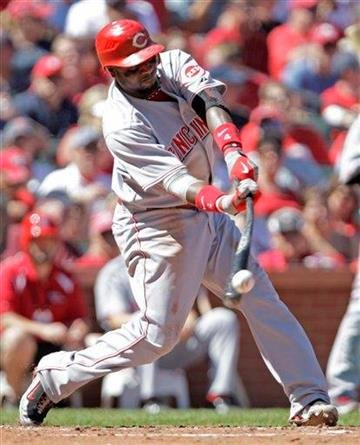 Cincinnati Reds' Brandon Phillips (4) connects for a base hit in the fifth inning of a baseball game against the St. Louis Cardinals, Sunday, Sept. 5, 2010 in St. Louis.(AP Photo/Tom Gannam) By Tom Gannam