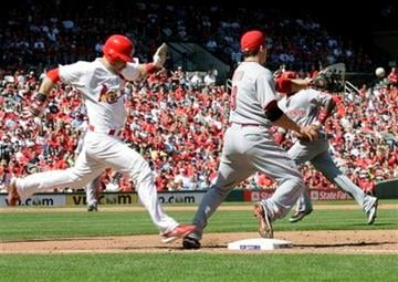 St. Louis Cardinals' Skip Schumaker (55) nearly beats the throw to first as Cincinnati Reds first baseman Joey Votto waits for the ball in the sixth inning of a baseball game, Sunday, Sept. 5, 2010 in St. Louis.(AP Photo/Tom Gannam) By Tom Gannam