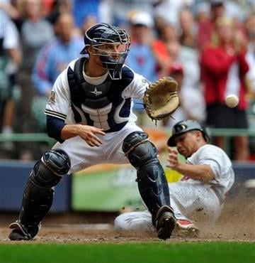 Milwaukee Brewers' Jonathan Lucroy waits for the ball as St. Louis Cardinals' Jon Jay scores the go ahead runduring the eighth inning of a baseball game Monday, Sept. 6, 2010, in Milwaukee. (AP Photo/Jim Prisching) By Jim Prisching