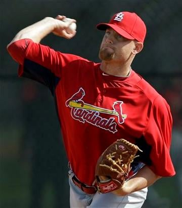 St. Louis Cardinals pitcher Kyle McClellan throws in the bullpen during spring training baseball Sunday, Feb. 27, 2011, in Jupiter, Fla. (AP Photo/Jeff Roberson) By Jeff Roberson