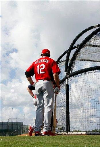 St. Louis Cardinals' Lance Berkman (12) waits to take his turn at batting practice during spring training baseball Sunday, Feb. 27, 2011, in Jupiter, Fla. (AP Photo/Jeff Roberson) By Jeff Roberson
